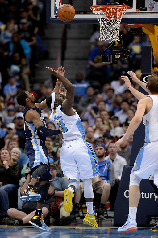 . Denver Nuggets guard Ty Lawson (3) makes a shot as Memphis Grizzlies guard Mike Conley (11) defends during the third quarter of action. (Photo by AAron Ontiveroz/The Denver Post)