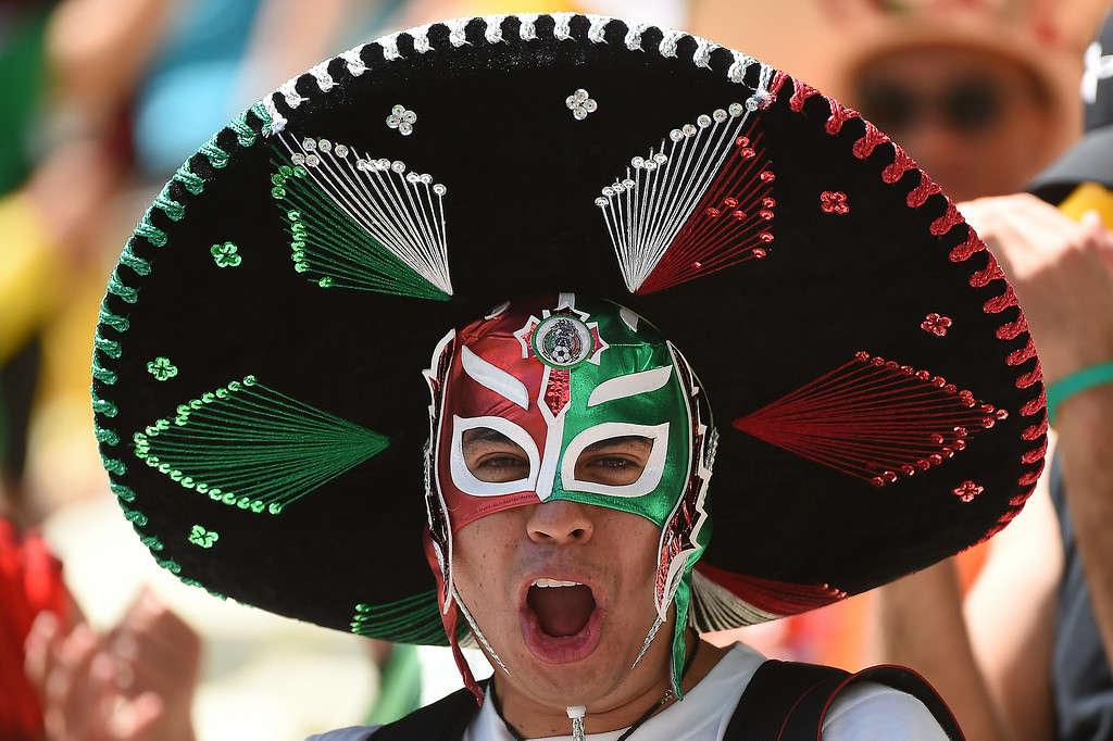 . A Mexican supporter cheers for his team ahead of the Round of 16 football match between Netherlands and Mexico at Castelao Stadium in Fortaleza during the 2014 FIFA World Cup on June 29, 2014.  EMMANUEL DUNAND/AFP/Getty Images