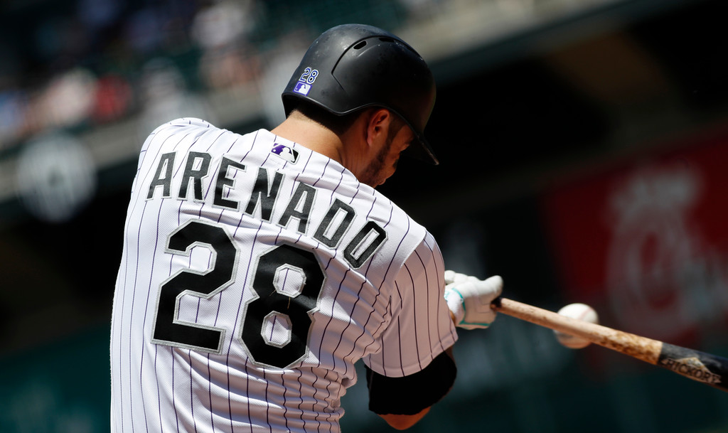 . Colorado Rockies\' Nolan Arenado fouls off a pitch from Cleveland Indians starting pitcher Trevor Bauer in the first inning of an interleague baseball game Wednesday, June 7, 2017, in Denver. (AP Photo/David Zalubowski)