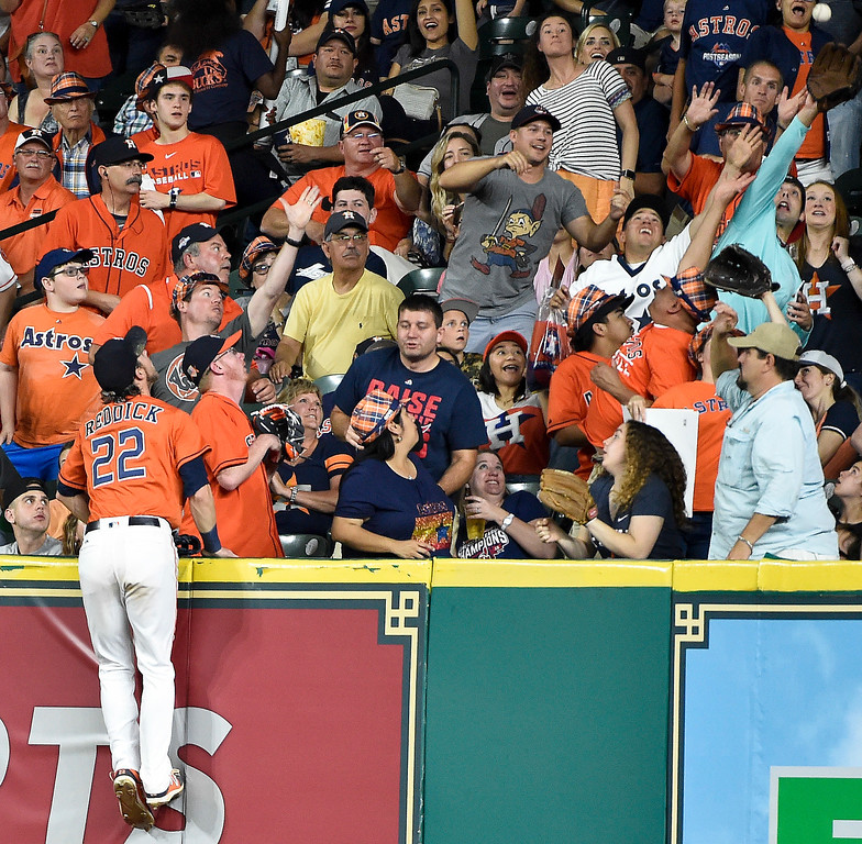 . Houston Astros right fielder Josh Reddick (22) watches the solo home run of Cleveland Indians\' Jason Kipnis during the fifth inning of a baseball game, Friday, May 19, 2017, in Houston. (AP Photo/Eric Christian Smith)