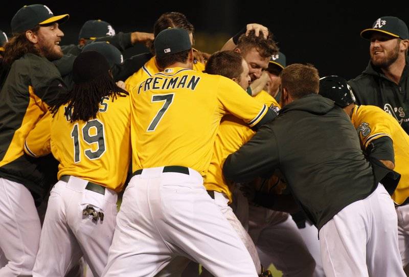 ". <p>7. OAKLAND ATHLETICS <p>You�ve gotta love their new postgame tradition: throwing their teammates into the dugout sewage. (unranked) <p><b><a href=\'http://nesn.com/2013/09/athletics-home-dugout-flooded-by-backed-up-sewage-which-jed-lowrie-calls-kind-of-repulsive/\' target=""_blank\""> HUH?</a></b> <p>    (AP Photo/George Nikitin)"