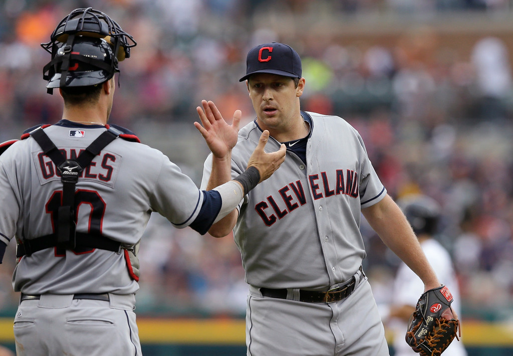 . Cleveland Indians relief pitcher Bryan Shaw shakes hand with catcher Yan Gomes after their 6-2 win over the Detroit Tigers in the first baseball game of a doubleheader, Saturday, July 19, 2014 in Detroit. (AP Photo/Carlos Osorio)