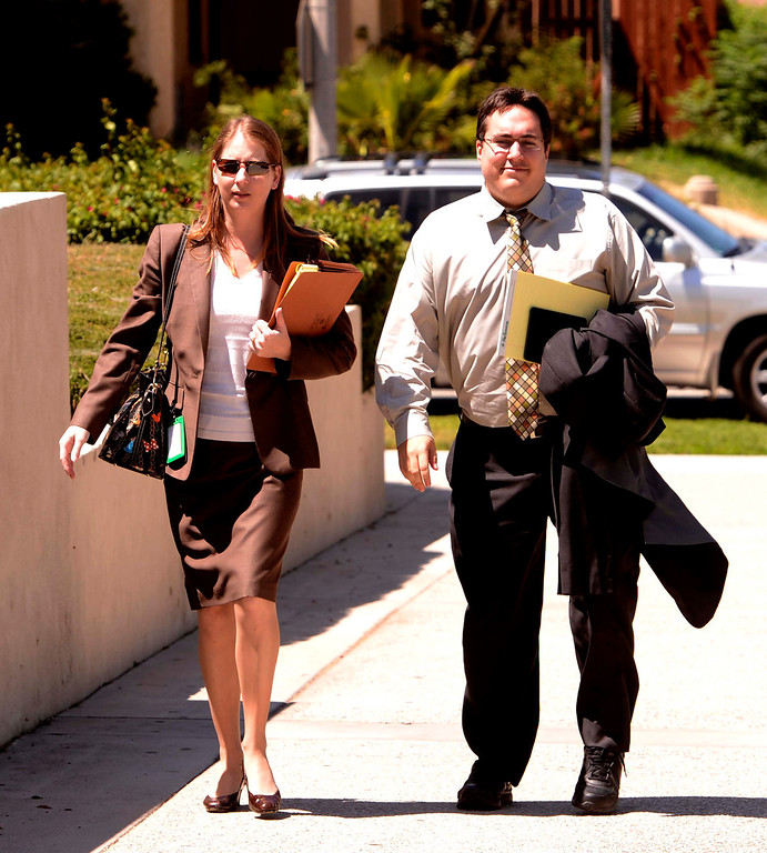 . Staff of City Attorney James Penman arrive to the United States Bankruptcy court in Riverside August 28,2013.  A tentative ruling by a Federal judge grants San Bernardino bankrupty protection.  GABRIEL LUIS ACOSTA/STAFF PHOTOGRAPHER.
