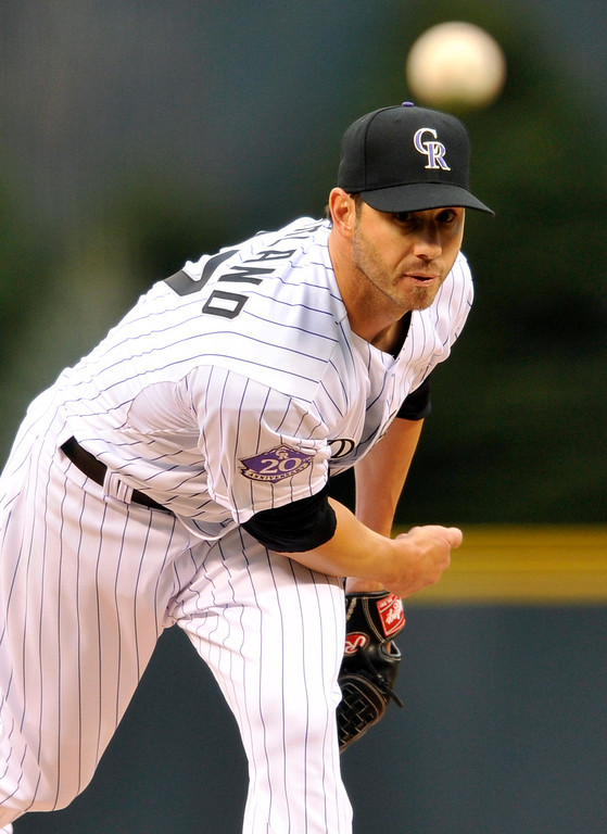 . Colorado Rockies starting pitcher Jon Garland throws to the plate against the San Diego Padres during the first inning of a baseball game on Saturday, April 6, 2013, in Denver. (AP Photo/Jack Dempsey)