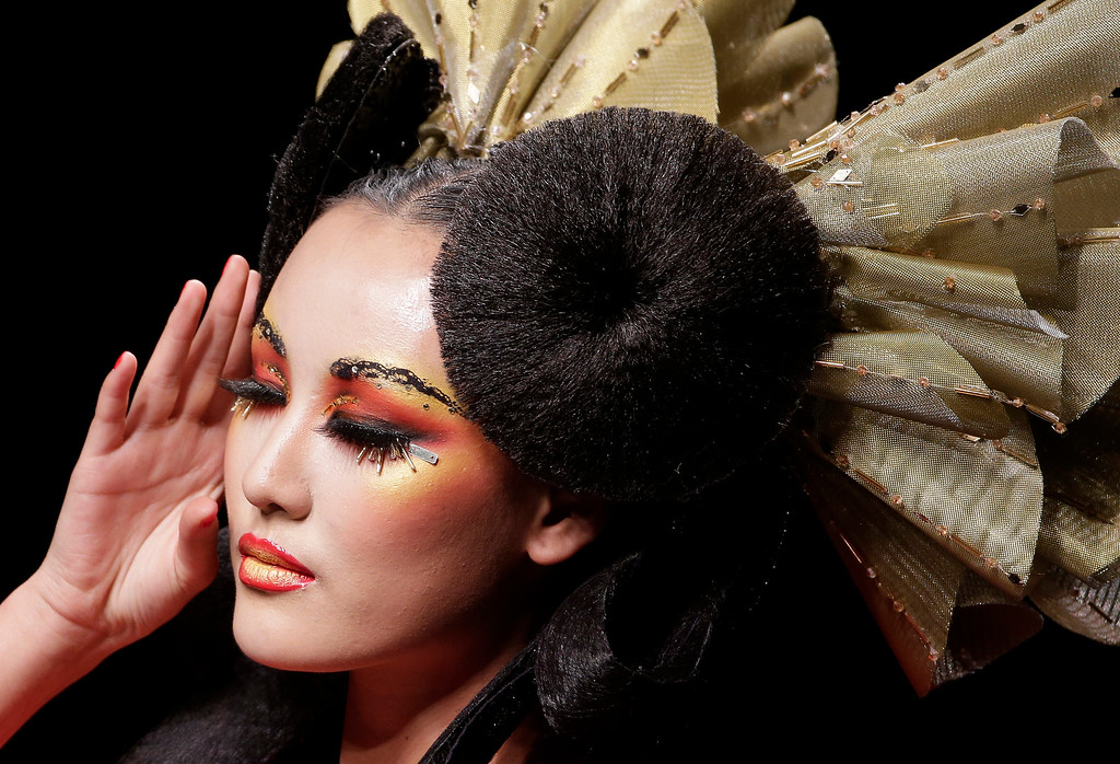 . A model presents a creation at MGPIN 2015 Mao Geping Makeup Trends Launch collection during China Fashion Week in Beijing, China Monday, Oct. 27, 2014. (AP Photo/Andy Wong)