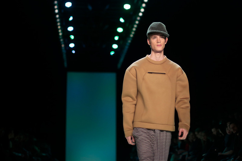 . A model wears a creation of fashion label Marc Stone\'s Autumn Winter 2014 collection during the Mercedes Benz Fashion Week in Berlin, Tuesday, Jan. 14, 2014. (AP Photo/Markus Schreiber)