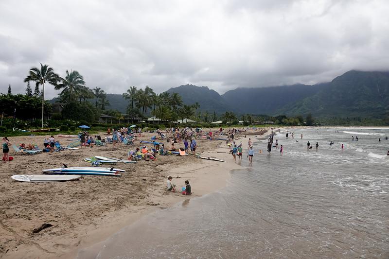 Hanalei beach is often covered in rain. On a slightly sunny day, beachgoers flood the area,