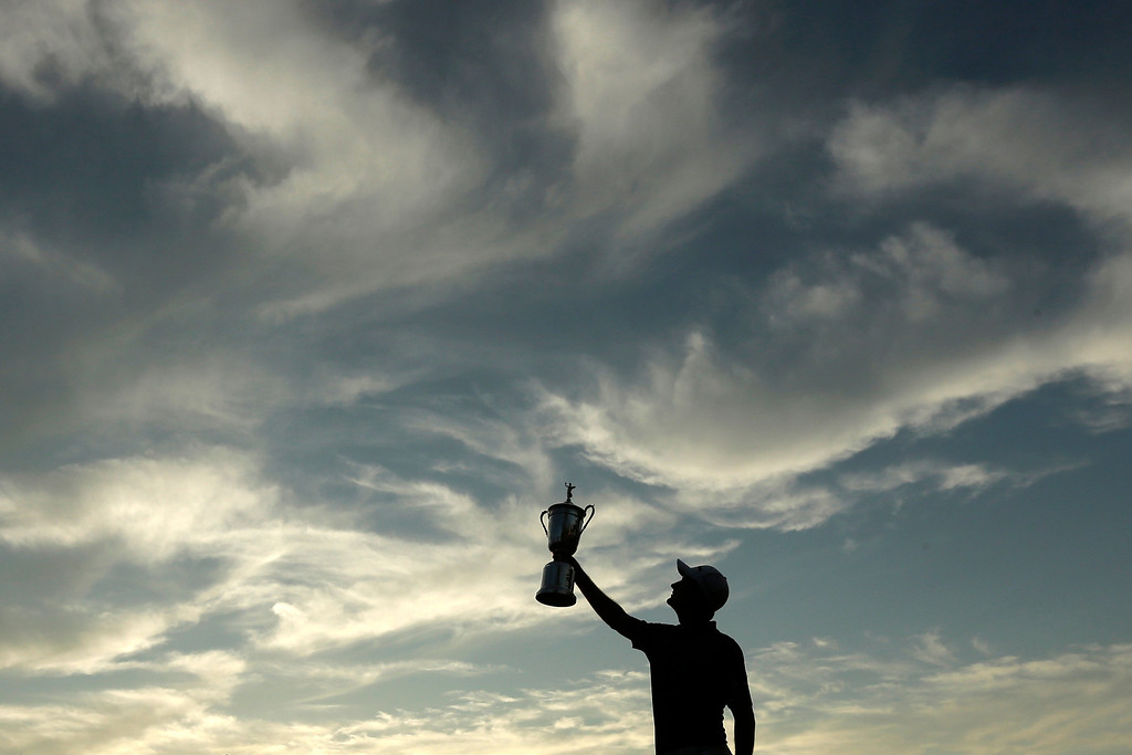 . Justin Rose, of England, poses with the trophy after winning the U.S. Open golf tournament at Merion Golf Club, Sunday, June 16, 2013, in Ardmore, Pa. (AP Photo/Charlie Riedel, File)