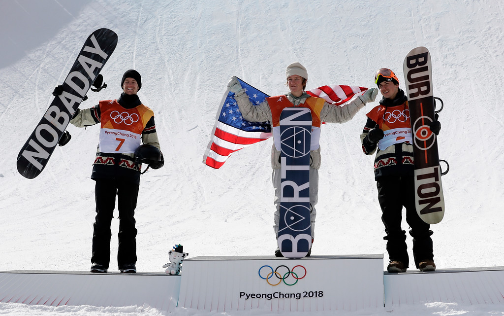 . From left: Silver medal winner Max Parrot, of Canada (7), gold medal winner Red Gerard, of the United States (6), and Bronze medal winner Mark McMorris, of Canada, cheer during the medal recognition ceremony after the men\'s slopestyle final at Phoenix Snow Park at the 2018 Winter Olympics in Pyeongchang, South Korea, Sunday, Feb. 11, 2018. (AP Photo/Lee Jin-man)