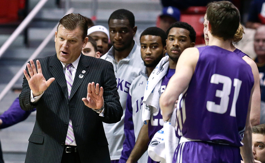 . Stephen F. Austin head coach Brad Underwood, left, reacts during the first half of a third-round game against UCLA in the NCAA college basketball tournament, Sunday, March 23, 2014, in San Diego.  (AP Photo/Gregory Bull)