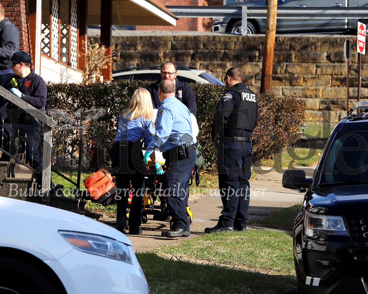EMS officials respond to  alleged stabbing on Wayne St. Tuesday.  Seb Foltz/Butler Eagle