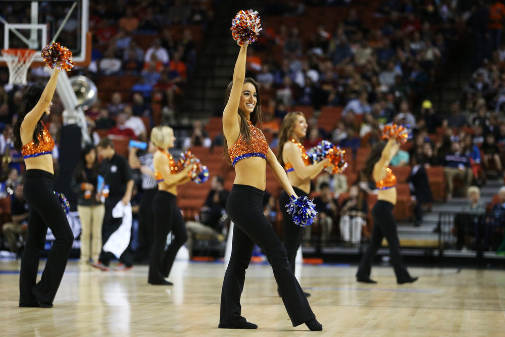 . Florida Gators cheerleaders perform in the first half against the Minnesota Golden Gophers during the third round of the 2013 NCAA Men\'s Basketball Tournament at The Frank Erwin Center on March 24, 2013 in Austin, Texas.  (Photo by Ronald Martinez/Getty Images)