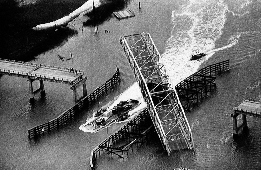 . In this Sept. 28, 1989 file photo, a ferry plies the Intracoastal Waterway by the Ben Sawyer Bridge between Sullivans Island, S.C., and the South Carolina mainland. The bridge was damaged by Hurricane Hugo which hit on Sept. 21, 1989. (AP Photo/The Post and Courier, Wade Spees, File)