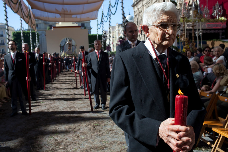 Old man bearing a candle, Corpus Christi procession, Seville, Spain, 2009.