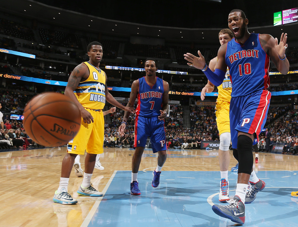 . Detroit Pistons center Greg Monroe, right, reacts as he loses the ball out of play as, from left, Denver Nuggets guard Aaron Brooks, Pistons guard Brandon Jennings and Nuggets center Timofey Mozgov, of Russia, look on in the first quarter of an NBA basketball game in Denver on Wednesday, March 19, 2014. (AP Photo/David Zalubowski)