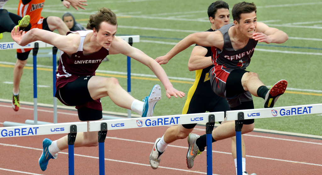 . Maribeth Joeright/MJoeright@News-Herald.com University School\'s Peter Simon and Geneva\'s Luke Murray run a close race in the boys 110 meter hurdles during the PAC meet at SPIRE Institute, May 15, 2014.