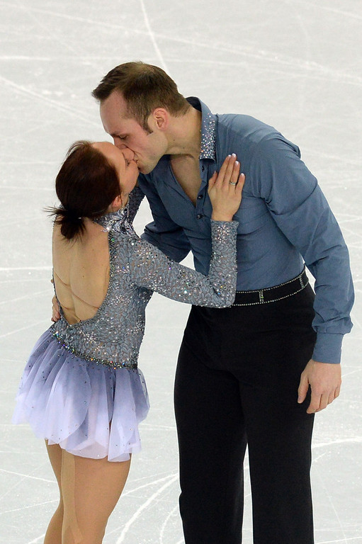. Germany\'s Daniel Wende and Germany\'s Maylin Wende kiss after competing in the Figure Skating Pairs Team Short Program at the Iceberg Skating Palace during the Sochi Winter Olympics on February 6, 2014.  (YURI KADOBNOV/AFP/Getty Images)