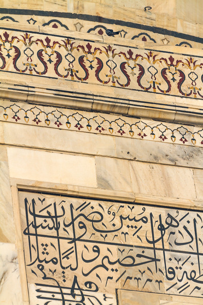 Details of the scroll work and writings from the Quran on the Taj Mahal