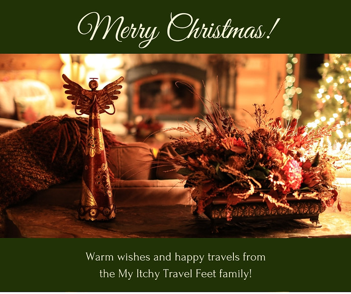 Merry Christmas! Photo of angel on a table with Christmas tree and fireplace in the background.