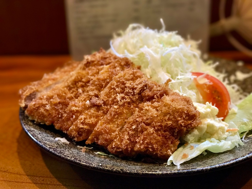 Hot, crispy breadcrumb batter encasing slices of moist pork loin.