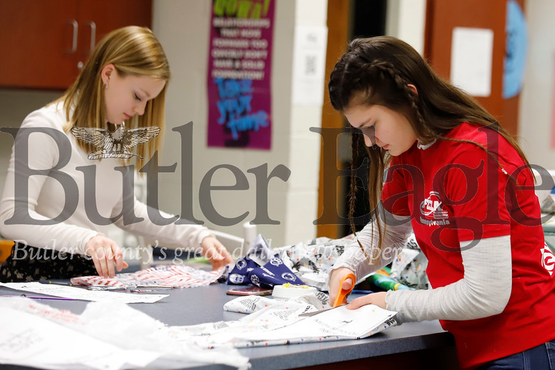 Seneca Valley juniors Alyssa Dunning (left) and Ashley Pelloni cut patterns for marsupial pouches and bat wraps to send to aid animals effected by Australia's wildfires. Seb Foltz/Butler Eagle