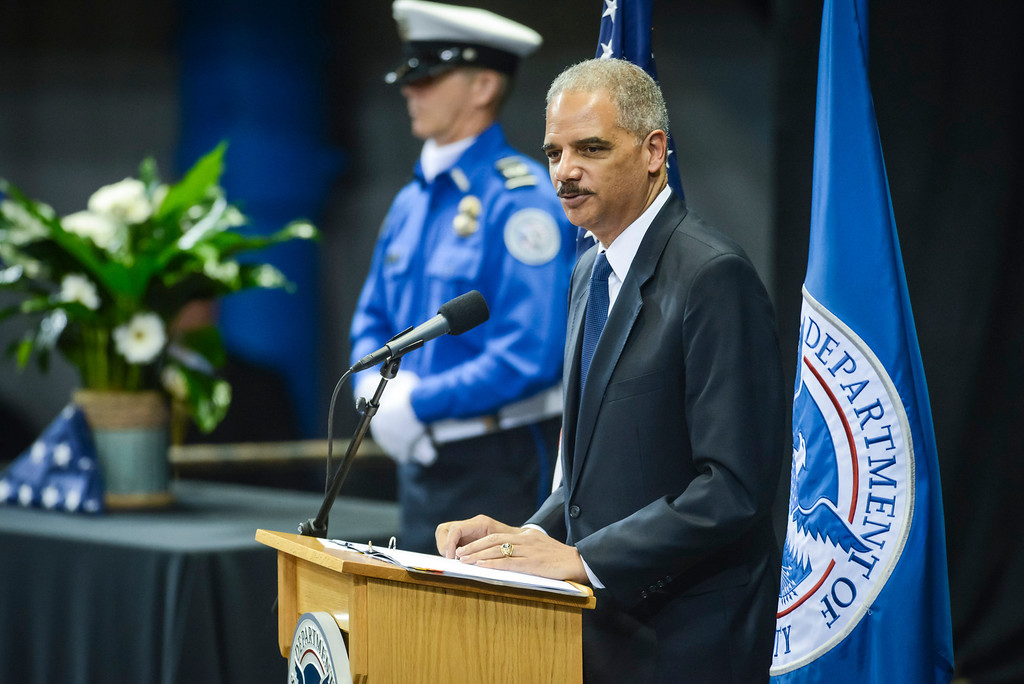. Attorney General Eric Holder speaks at the memorial for slain TSA officer Gerardo Hernandez at the Los Angeles Sports Arena Tuesday, November 12, 2013.  A public memorial was held for Officer Hernandez who was killed at LAX when a gunman entered terminal 3 and opened fire with a semi-automatic rifle, Grigsby was wounded in the attack.  ( Photo by David Crane/Los Angeles Daily News )
