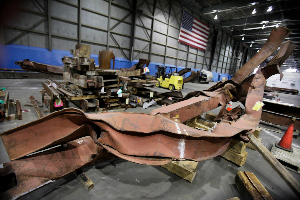 . In this Wednesday, March 23, 2011 file photo, twisted beams and other remains from the attacks at the World Trade Center sit in Hangar 17 at New York\'s John F. Kennedy International Airport. �They are the relics of the destruction and they have the same power in the same way as medieval relics that have the power of the saints,� says Harriet Senie, a professor of art history at the City University of New York and author of �Memorials to Shattered Myths: Vietnam to 9/11.� (AP Photo/Richard Drew)