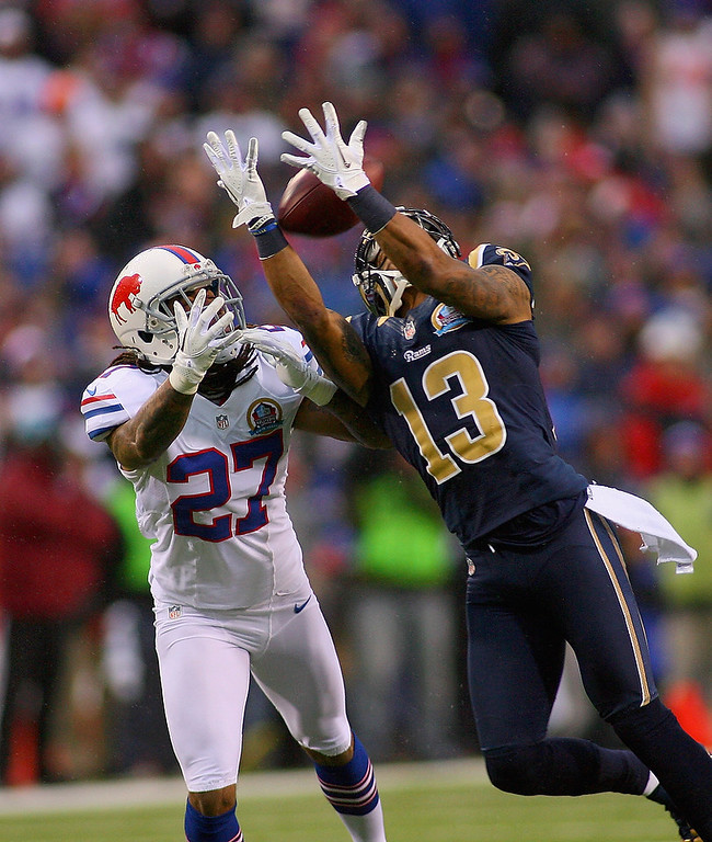 . Chris Givens #13 of the St. Louis Rams reaches for a pass with  Stephon Gilmore #27 of the Buffalo Bills defending  at Ralph Wilson Stadium on December 9, 2012 in Orchard Park, New York. Givens couldn\'t make the reception. St Louis won 14-12. (Photo by Rick Stewart/Getty Images)