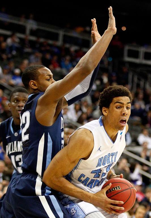 . KANSAS CITY, MO - MARCH 22:  James Michael McAdoo #43 of the North Carolina Tar Heels is defended by James Bell #32 of the Villanova Wildcats in the second half during the second round of the 2013 NCAA Men\'s Basketball Tournament at the Sprint Center on March 22, 2013 in Kansas City, Missouri.  (Photo by Ed Zurga/Getty Images)