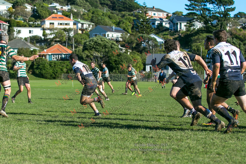 J Styche from Petone with the ball at  the Wellington Premier reserve rugby union match (Harper Lock Shield) between Old Boys University RFC (white) and Petone RFC (blue) at Nairnville Park, Wellington, New Zealand on 2 June 2018.    SCORE : Petone 17; OBU 24 Copyright John Mathews 2018 http://www.megasportmedia.co.nz