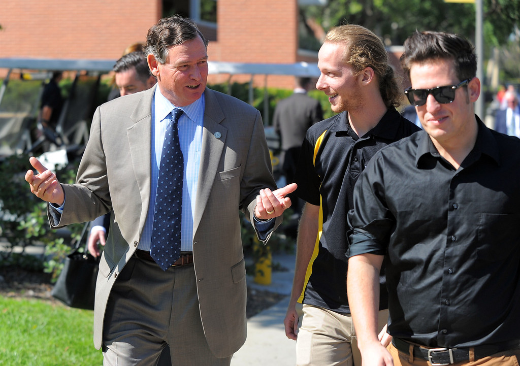 . CSU Chancellor Timothy P. White walks to the student union with ASI President John Haberstroh, center and ASI V.P. Jonathon Bolin, right, as he tours Cal State Long Beach on Monday, October 14, 2013.  (Photo by Scott Varley, Daily Breeze)