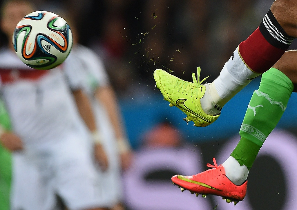 . Germany\'s defender Jerome Boateng (L) and Algeria\'s forward El Arabi Soudani vie for the ball during a Round of 16 football match between Germany and Algeria at Beira-Rio Stadium in Porto Alegre during the 2014 FIFA World Cup on June 30, 2014.   KIRILL KUDRYAVTSEV/AFP/Getty Images