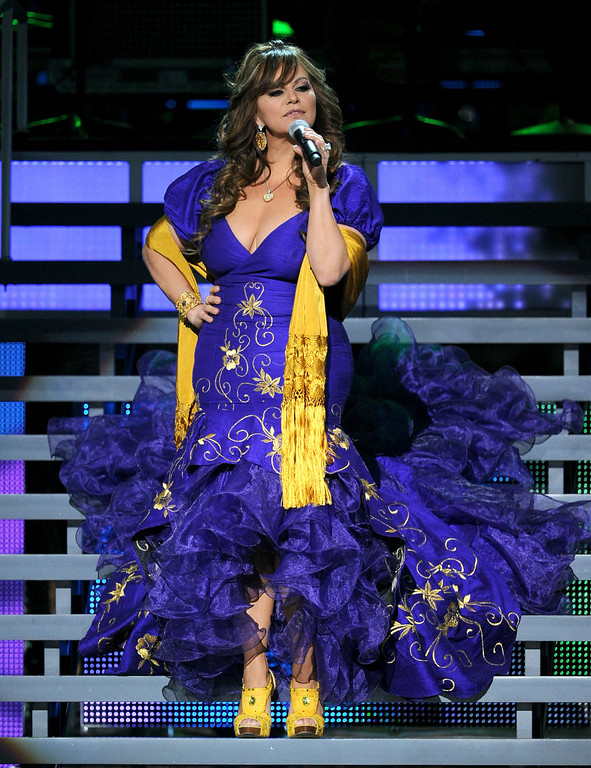 . Singer Jenny Rivera was the first female banda artist to sell out a concert at the Gibson Amphitheatre.   <br />Rivera performs onstage during the 11th annual Latin GRAMMY Awards at the Mandalay Bay Events Center on November 11, 2010 in Las Vegas, Nevada.     (Photo by Kevin Winter/Getty Images for LARAS)
