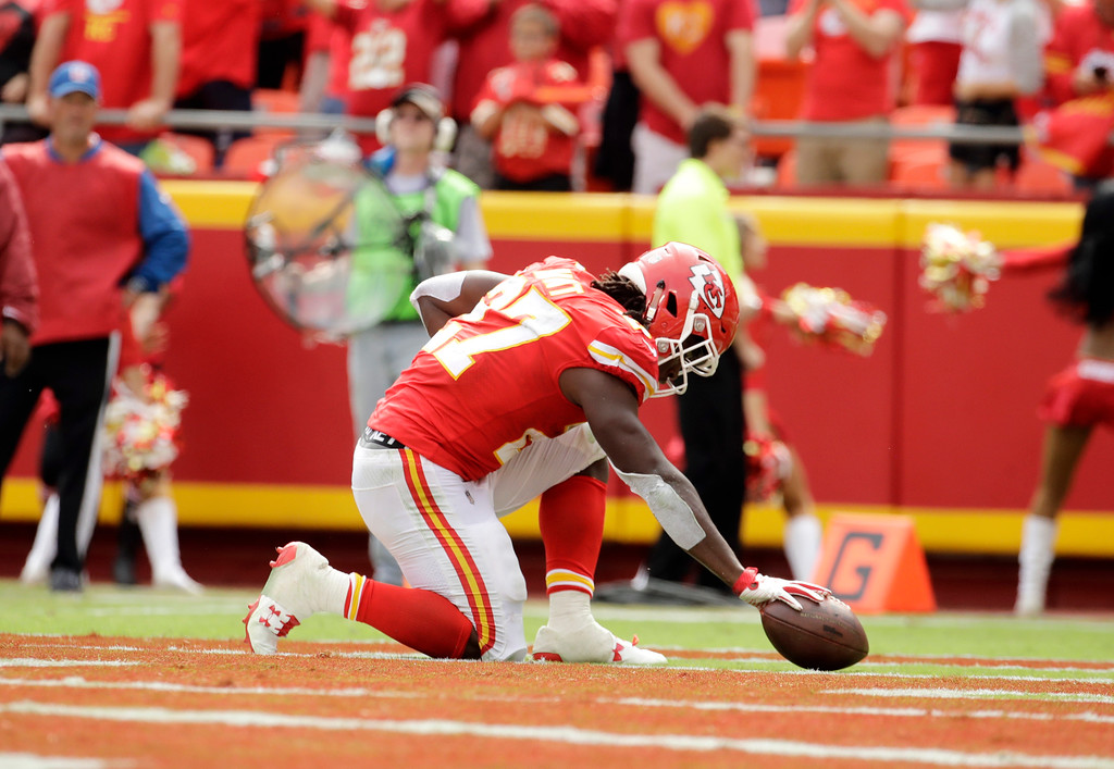 . Kansas City Chiefs running back Kareem Hunt (27) celebrates a touchdown against the Philadelphia Eagles during the second half of an NFL football game in Kansas City, Mo., Sunday, Sept. 17, 2017. (AP Photo/Charlie Riedel)