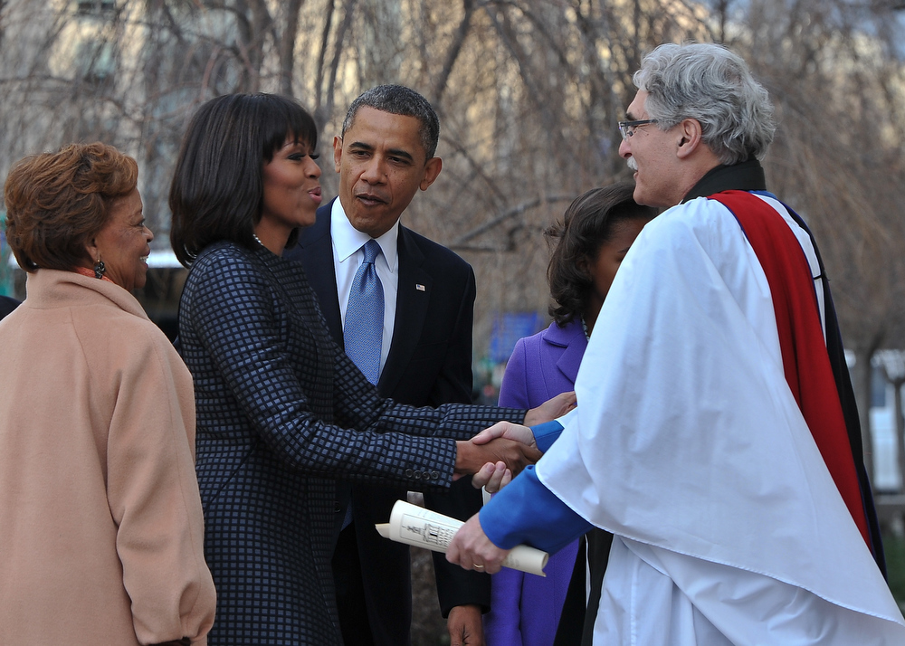 . US President Barack Obama, First Lady Michelle Obama and her mother Marian Robinson are greeted by Rev. Luis Leon as they arrive at St. John\'s Church on January 21, 2013 in Washington, DC, hours before Obama participates in a ceremonial swearing in for a second term in office.  AFP PHOTO/Nicholas KAMMNICHOLAS KAMM/AFP/Getty Images