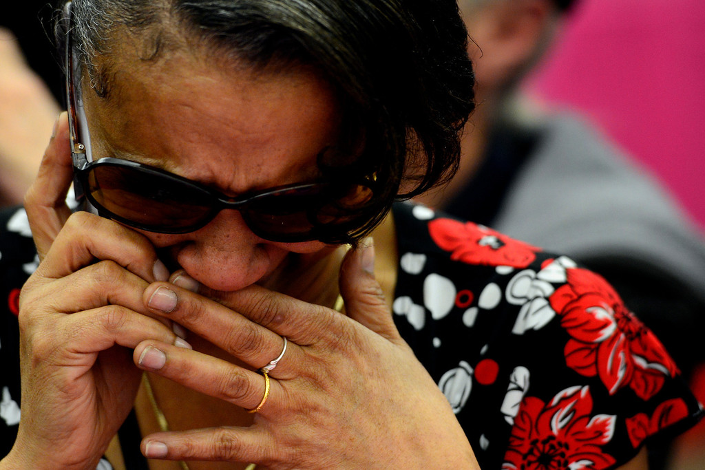 . DENVER, CO - FEBRUARY 14: Lavette Michelle Noel cries as she tells her boss that she is not coming into work today after she married Delani Eugene Simmons during a Valentine\'s Day marriage celebration at the Denver Clerk and Recorder\'s office. Couples applying for marriage licenses received gift bags containing gift certificates to local restaurants among other treats to celebrate their union. (Photo By AAron Ontiveroz/The Denver Post)