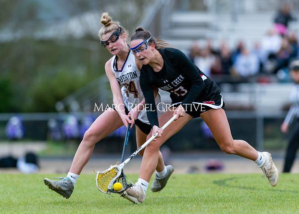 Broughton girls varsity lacrosse vs Middle Creek. February 28, 2020. D4S_0340