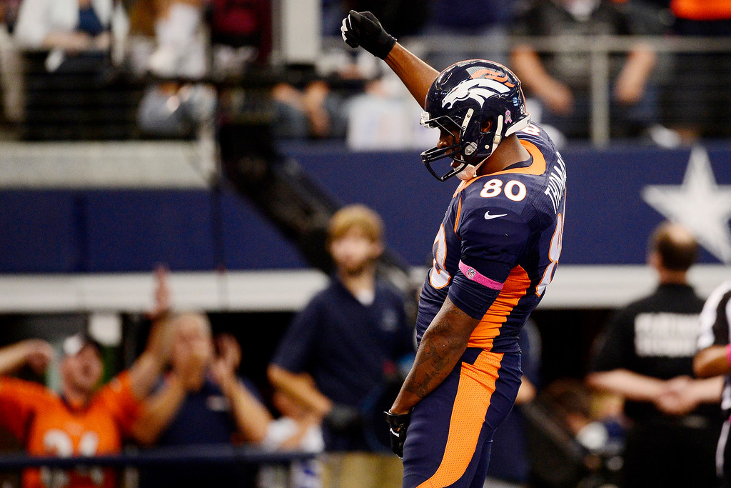 . Julius Thomas (80) of the Denver Broncos celebrates a touchdown catch against the Dallas Cowboys during the first half of action at AT&T Stadium.   (Photo by AAron Ontiveroz/The Denver Post)