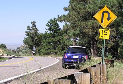 Rick finds another twistie to motor. This is one of several 15 MPH hairpins on the way back down Lookout Mountain, heading toward Golden, Colo. The glass is now tinted.