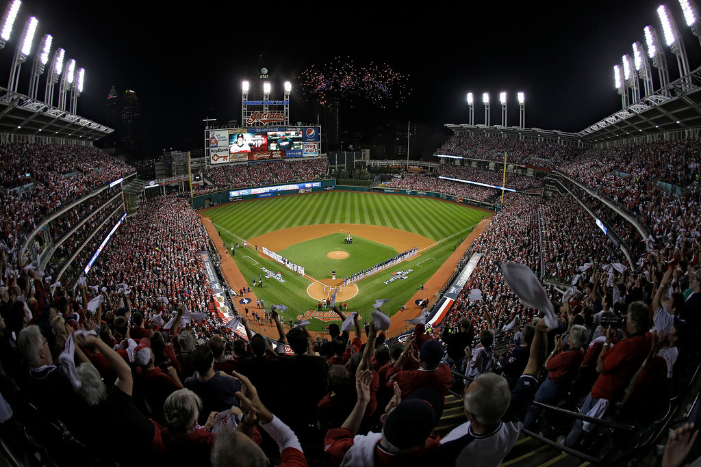 . Fans in the upper deck wave towels as the Cleveland Indians and the Tampa Bay Rays are introduced for thew AL wild-card baseball game Wednesday, Oct. 2, 2013, in Cleveland. (AP Photo/Mark Duncan)