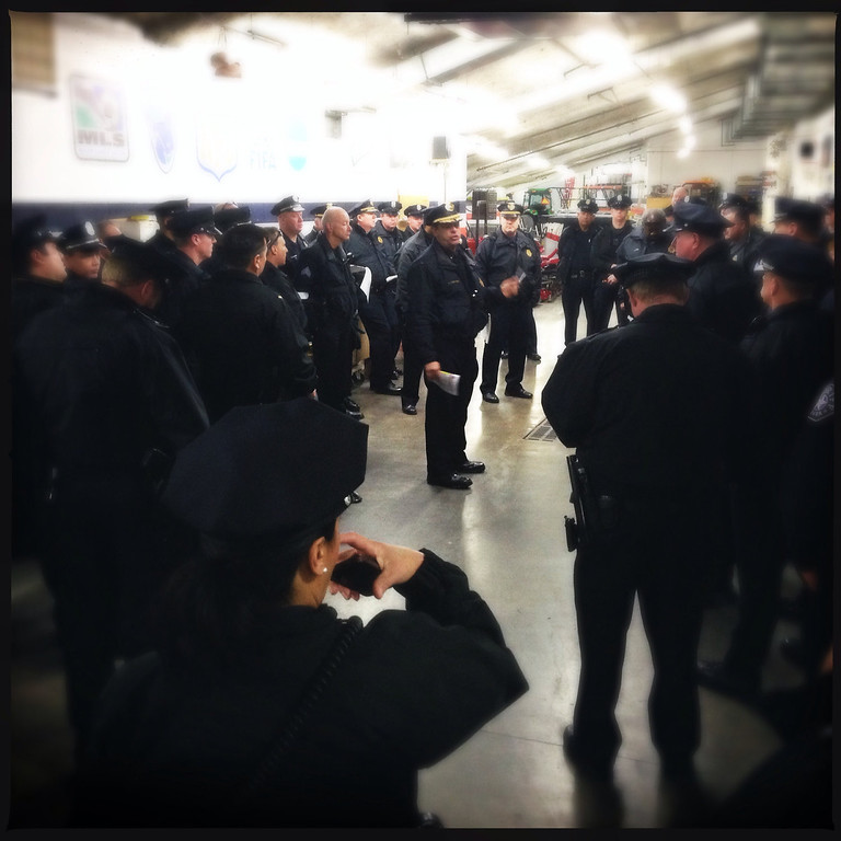 . Denver police pre game huddle. Photo by Joe Amon.