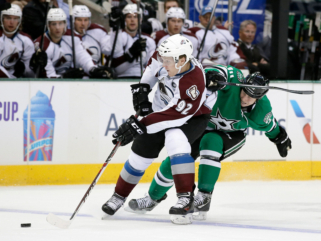 . Colorado Avalanche\'s Gabriel Landeskog (92), of Sweden, passes the puck as Dallas Stars\' Cody Eakin (20) defends during the second period of an NHL hockey game, Friday, Nov. 1, 2013, in Dallas. (AP Photo/Tony Gutierrez)