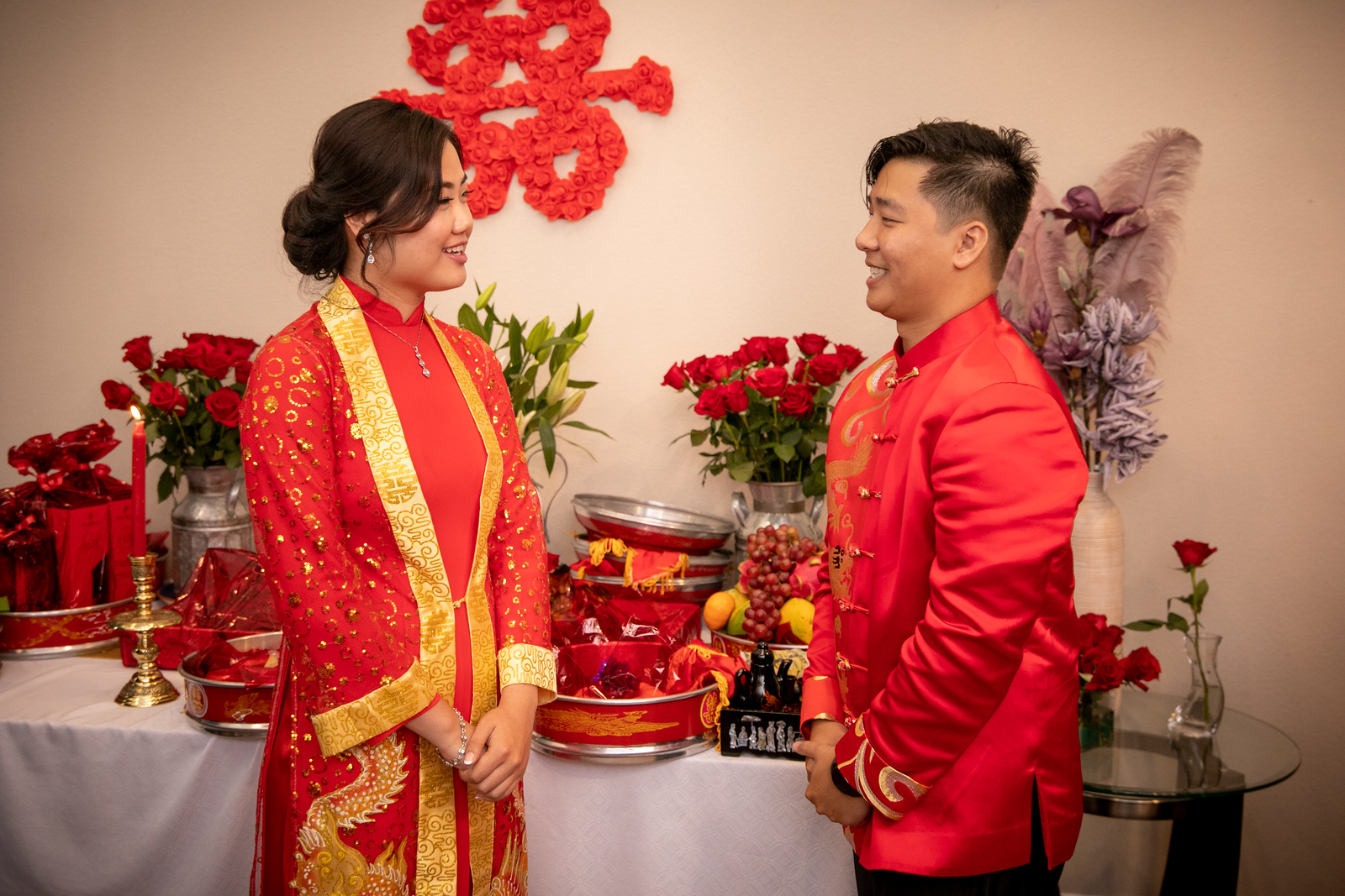 a bride and groom talking to one another at their wedding event