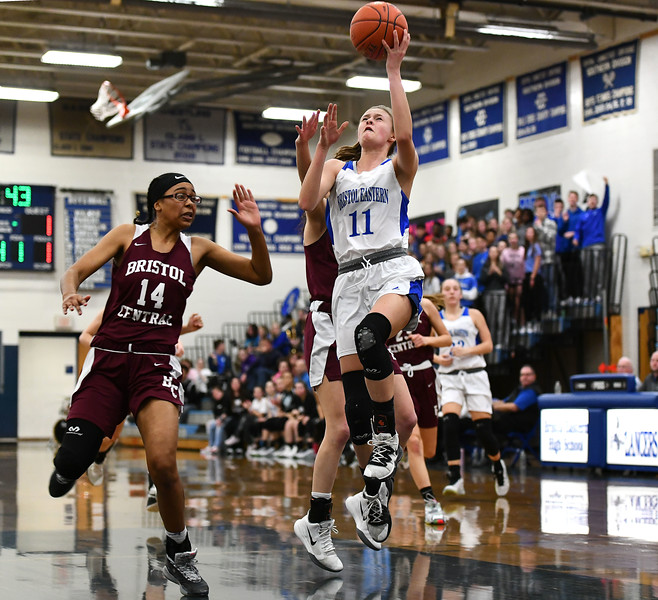 1/23/2020 Mike Orazzi | Staff Bristol Central's Janessa Bartell (14) and Bristol Eastern's Ciara Collins (11) during Thursday night's girls basketball game at Bristol Eastern.