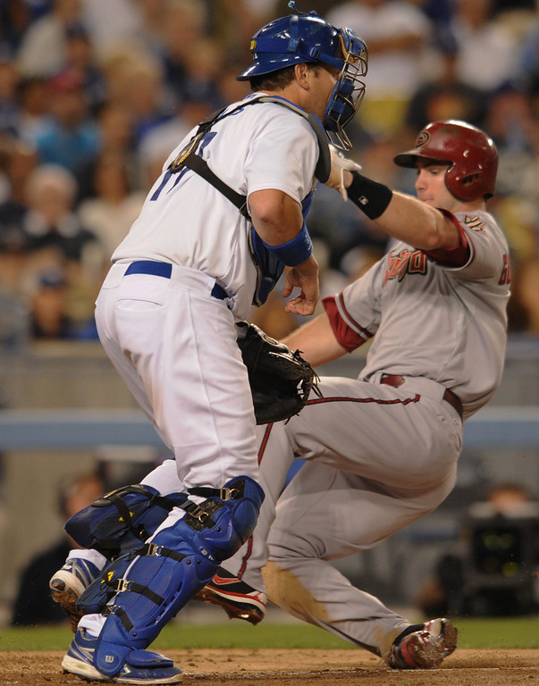 . Dbacks Paul Goldschmidt gets past Dodger catcher A.J. Ellis (the ball was not thrown to the plate), as he scores on a single hit by Miguel Montero in the 4th inning. The Dodgers played the Arizona Diamondbacks at Dodger Stadium in Los Angeles, CA. 9/10/2013. photo by (John McCoy/Los Angeles Daily News)