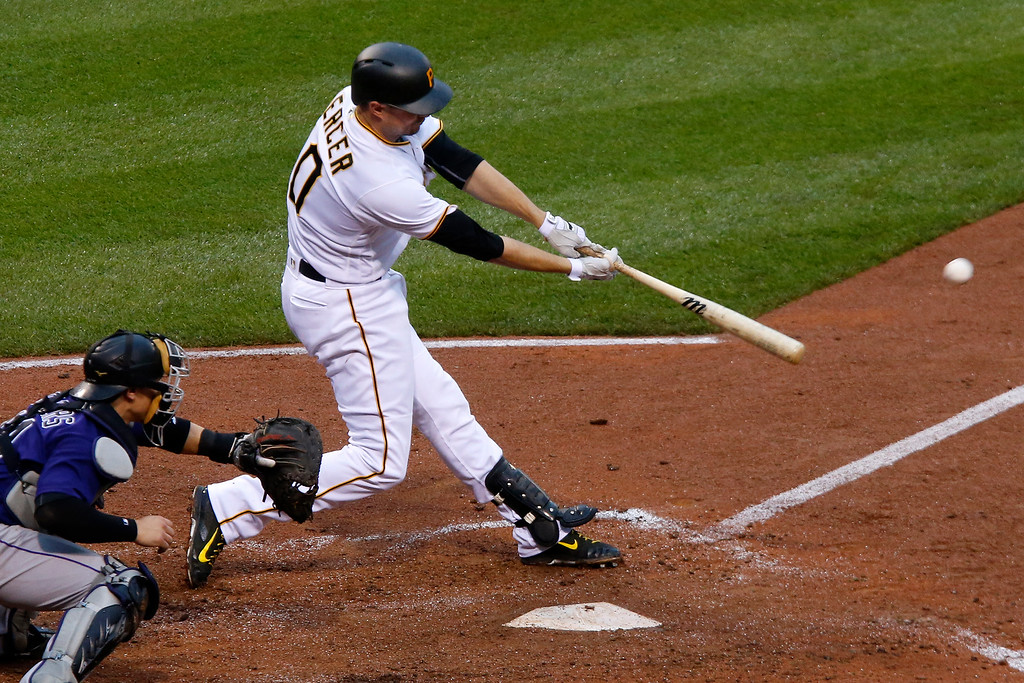 . Pittsburgh Pirates\' Jordy Mercer drives in a run with a single off Colorado Rockies starting pitcher Tyler Chatwood during the fourth inning of a baseball game against the Colorado Rockies in Pittsburgh, Saturday, May 21, 2016. (AP Photo/Gene J. Puskar)