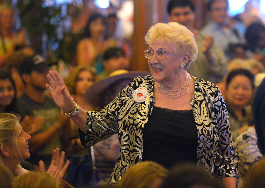 . June Allen waves to the crowd as the Queen Mary celebrates its 80th anniversary of her launching in Long Beach, CA on Friday, September 26, 2014. Allen sailed on the Queen Mary from her home in England to New York City after World War II with a group of English war bridew who married American GIs. After some speeches and a short film, guests were able to sample a slice of cake from a 15-foot long, 600-pound replica of the ship made by baker Jose Barajas. (Photo by Scott Varley, Daily Breeze)