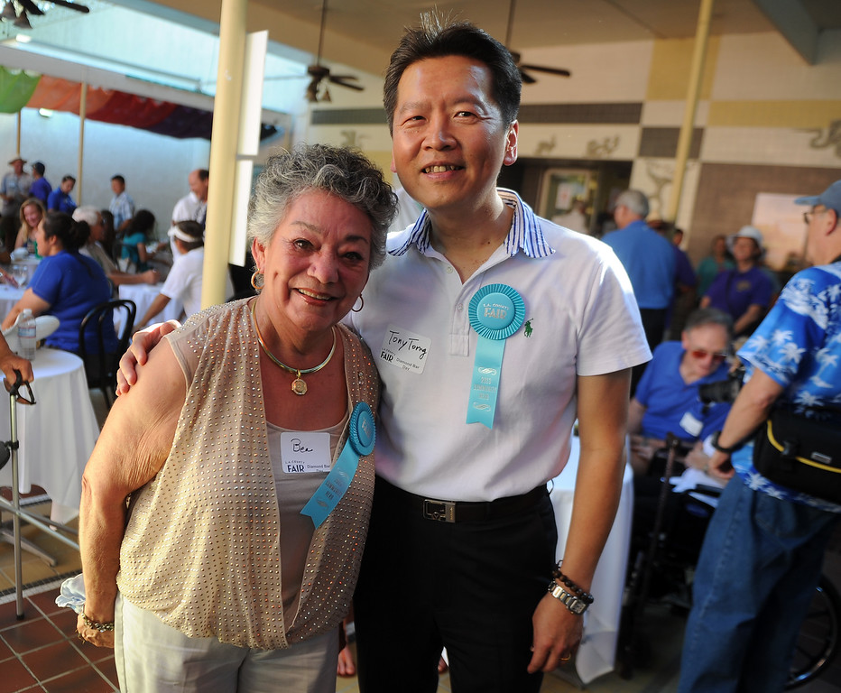 . Diamond Bar community heroes Bea McMillian, left, with Tony Yi Torng, pose for a photograph prior to the community parade during the 91st Annual L.A. County Fair in Pomona, Calif. on Thursday, Sept. 5, 2013.   (Photo by Keith Birmingham/Pasadena Star-News)