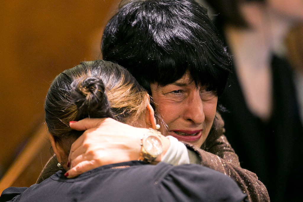 . Terri Hernandez, mother of former New England Patriots football player Aaron Hernandez hugs Shayanna Jenkins, Hernandez\'s fiancee, as the guilty verdict is read at the Bristol County Superior Court in Fall River, Mass., Wednesday, April 15, 2015.  Hernandez was found guilty of first-degree murder in the shooting death of Odin Lloyd in June 2013.  He faces a mandatory sentence of life in prison without parole.  (Dominick Reuter/Pool Photo via AP)