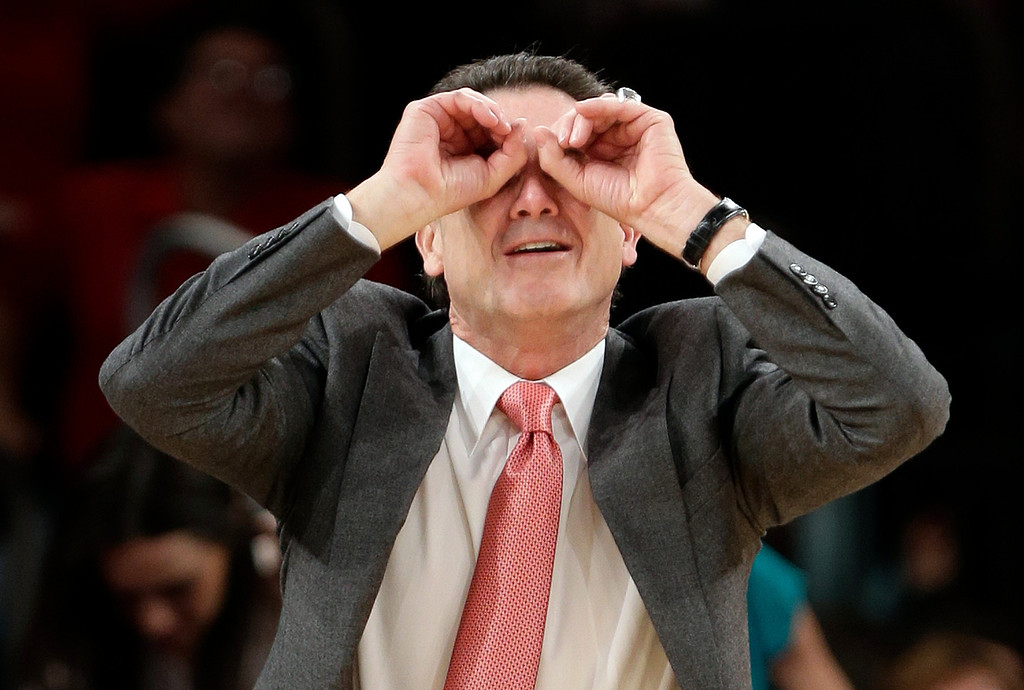 . Louisville coach Rick Pitino gestures to his team during the second half of an NCAA college basketball game against Notre Dame at the Big East Conference tournament Friday, March 15, 2013, in New York. Louisville won 69-57. (AP Photo/Frank Franklin II)